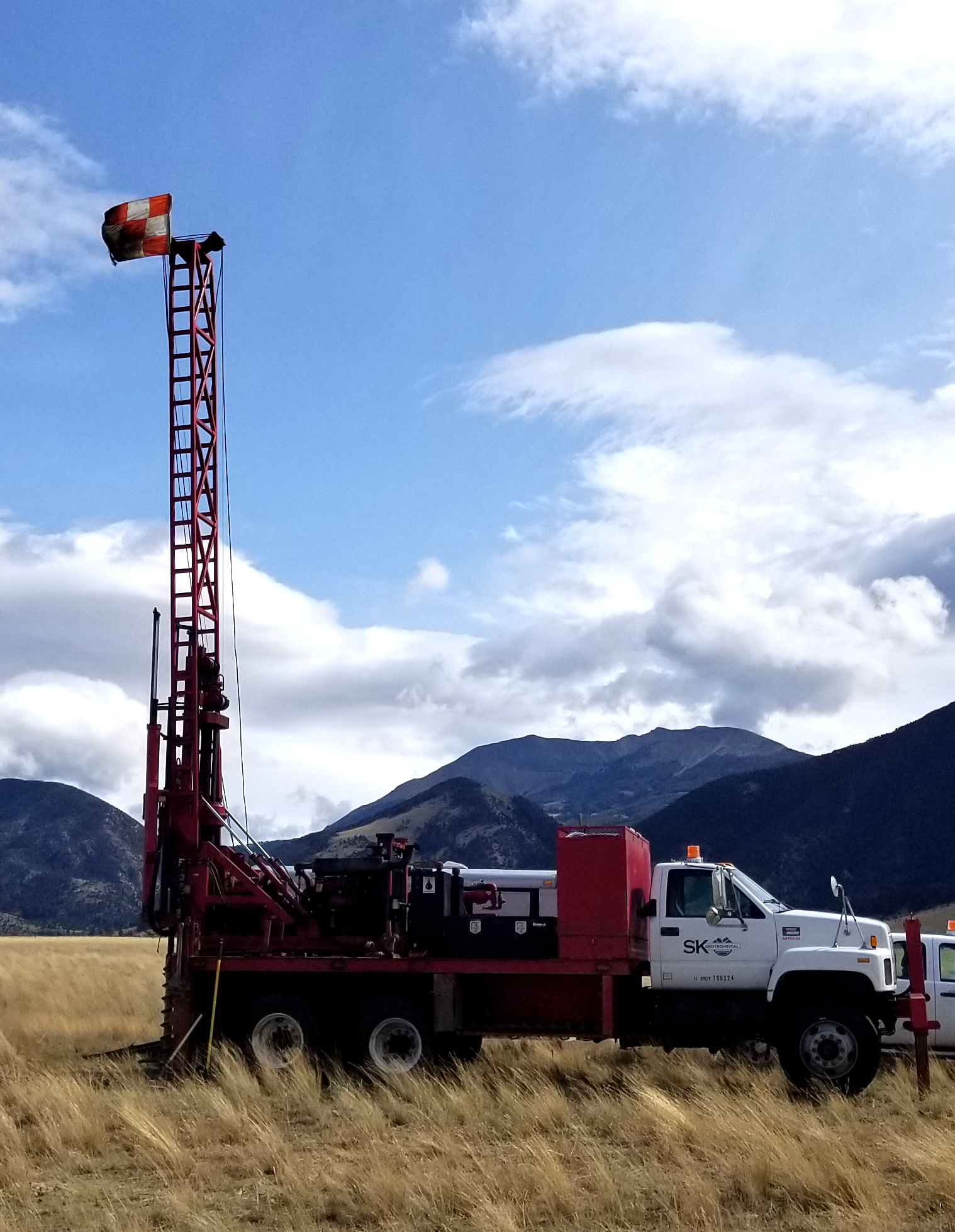Drill rig red truck mountains montana