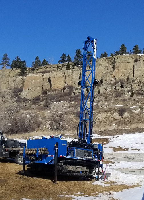 Blue drill rig cliffs Billings Montana Rubber Tracked